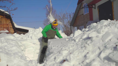 Man shoveling snow after snow storm Footage