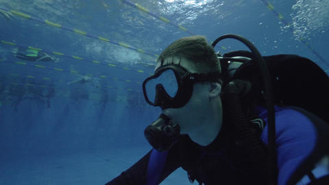 Man diver in scuba mask and diving equipment training in deep pool Footage