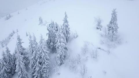 Flight over snowstorm in a snowy mountain, uncomfortable unfriendly winter Footage