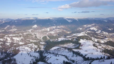 Flight over Carpathian mountains covered with snow. Clear frosty weather Footage