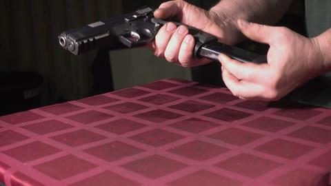 Loading the handgun magazine Live Action