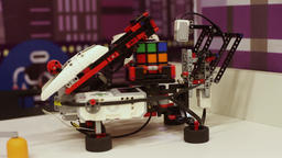 The robot itself quickly collects a cube of rubik. Modern robotic technologies Footage