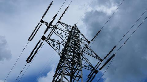 Electricity pylon with stormy sky Footage