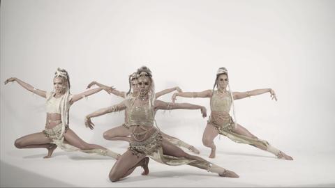 Modern glamorous oriental dances over white background Footage