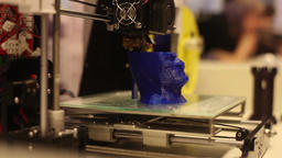 A 3D printer creates an image of a person's head. Modern robotic technologies Footage