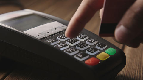 Hand swiping credit card on POS terminal Footage