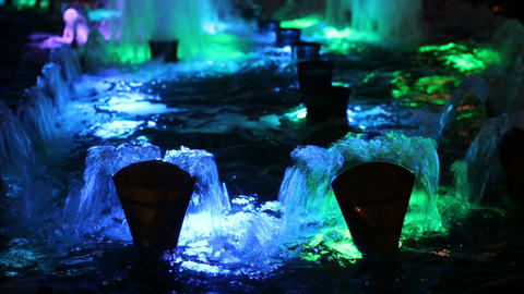 Beautiful water fountain flowing at night ビデオ