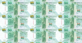 Banknotes of fifty dollars of Hong Kong rolling, cash money, loop Animation