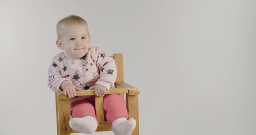 Cute baby smiling on a white studio background 影片素材