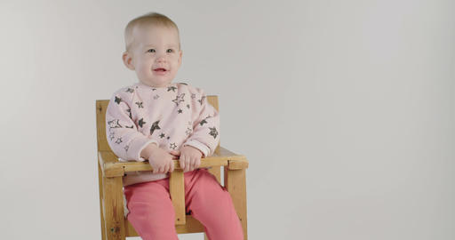 Cute baby smiling on a white studio background Footage