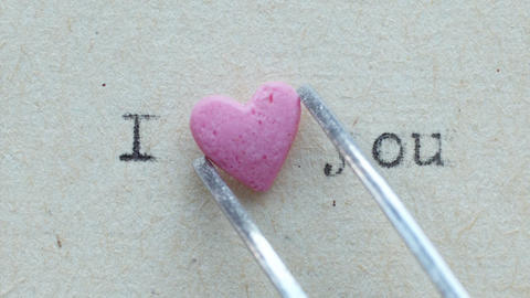 Heart shaped candy with loving words Footage
