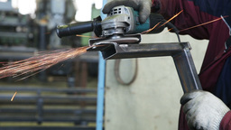 Worker cutting steel with angle grinder Footage