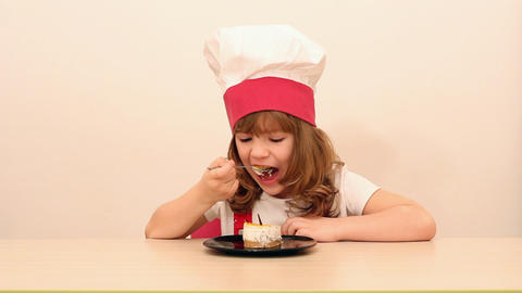 Hungry Little Girl Cook Eat Cake stock footage