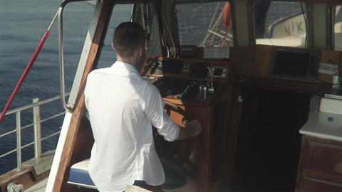 Young Man Behind The Wheel Of A Boat Footage