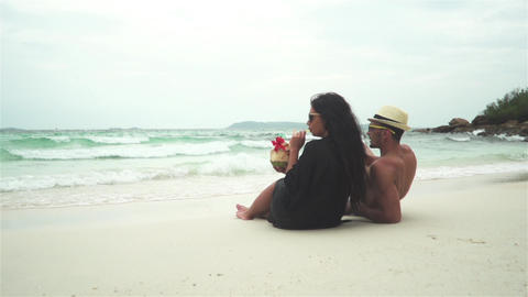 Couple Drinking Coconut On A Tropical Beach Footage
