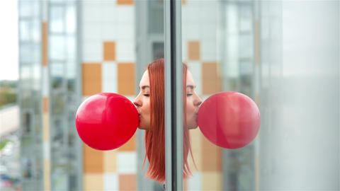 Girl Inflates A Red Balloon Footage