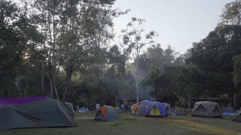 People have rest near the tent at campsite Footage