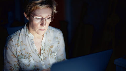 Middle-aged woman working on laptop Footage