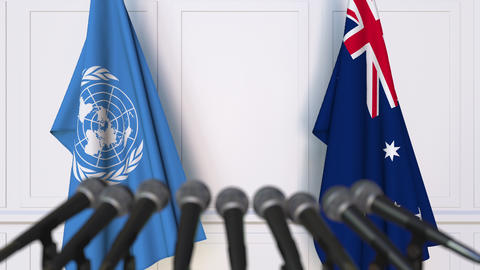 Flags of the United Nations and Australia at international meeting or Footage