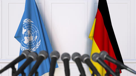 Flags of the United Nations and Germany at international meeting or negotiations Footage