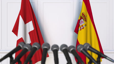 Flags of Switzerland and Spain at international meeting or negotiations press Footage