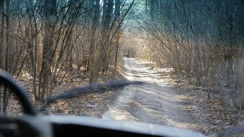 Driving off-road car throgh a forest. Driving old-fashioned off-road jeeps Footage