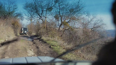 Driving old-fashioned off-road jeeps. Smooth footage from off road vehicle going Footage