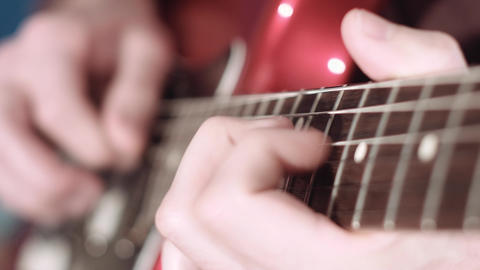 Close up of electrig guitar player hand performing a solo Footage