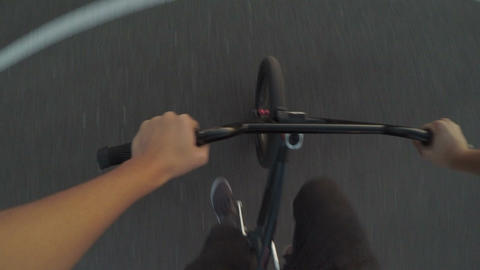 Point of view of sportive man pedaling and riding on his bicycle outdoor on Footage