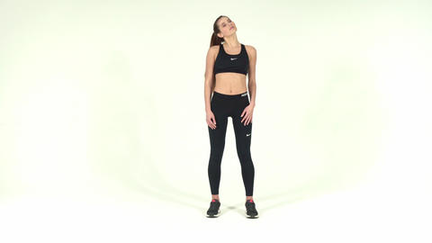 Fitness and healthy concept. Picture of sporty woman doing push-ups isolated on Footage