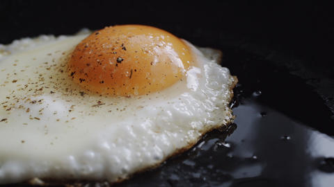 Egg fried in a pan Footage
