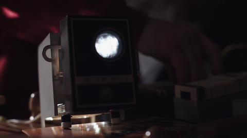 Man shows photos on the slide projector Stock Video Footage
