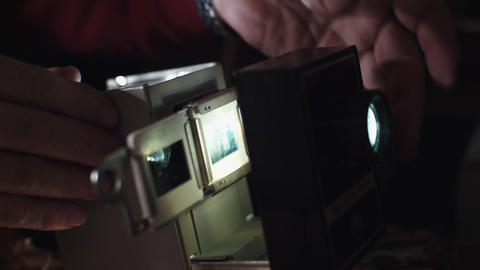Man shows photos on the slide projector Footage