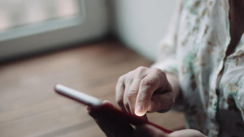Woman watching something on the smartphone screen Footage