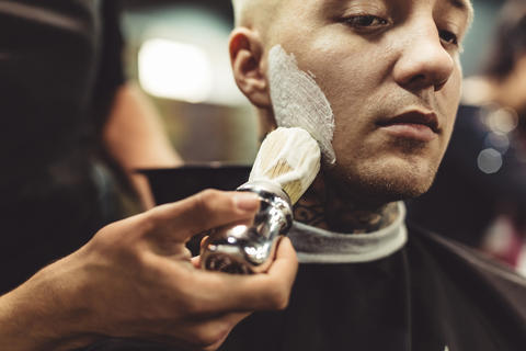 Anonymous barber shaving client Photo