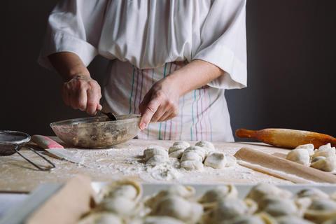 Two hands making meat dumplings Photo