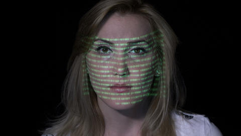 Attractive woman with blonde hair reading hacking warning texts on screen while Footage