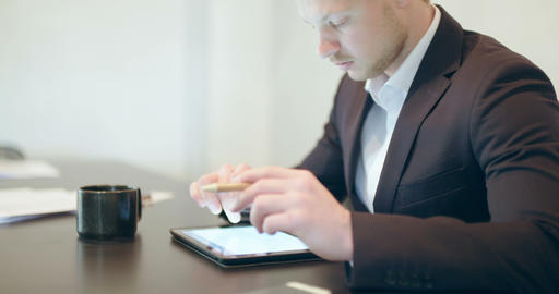 Man using tablet in Office (finance background) Footage