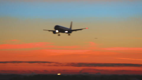 Airplane approaching at dawn Footage