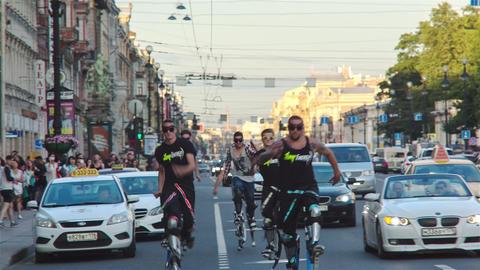 Men Walking On Jumping Stilts Footage