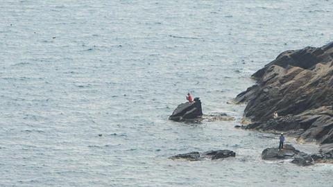 Azure Sea Fishermen on Rocky Beach Footage