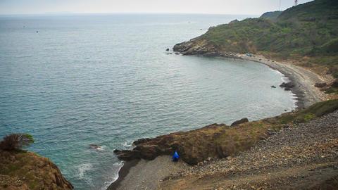 View of Azure Sea Stony Beach Waves Strike Rocks Footage