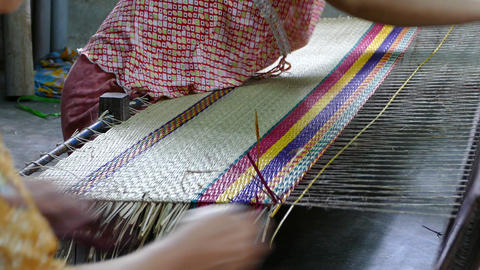 Two ladies weaving a matras in Hoi An Footage
