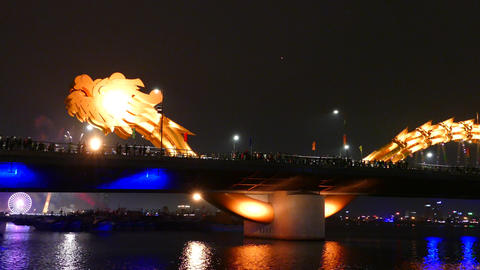 Dragon bridge with in the background fireworks celebrating Chinese New Year in D Footage