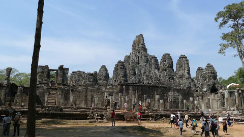 Big group of tourists walking towards the Bayon Khmer temple Footage
