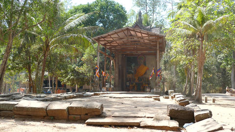Temple with a big buddha and flags in Angkor Wat Footage