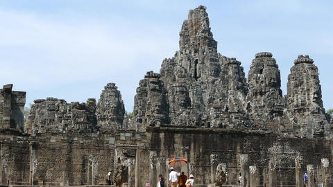 Monk and other tourists walking at the Bayon Khmer temple Footage
