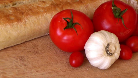 Zoom In Closeup White Bread, Tomatoes, Garlic, Cherry Tomatoes, Mediterranean Fo stock footage