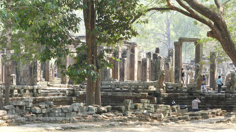 Monk and other tourists around the Bayon Khmer temple Footage