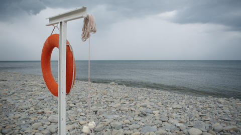 Lifebuoy hanging on the empty beach Footage